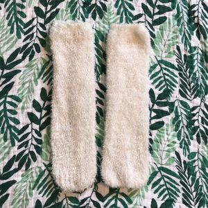 White fuzzy leg warmers